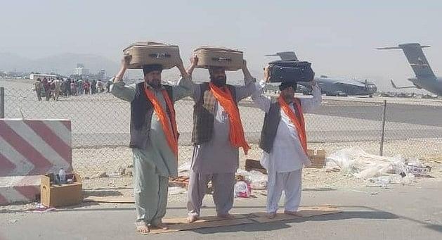 Afghan Sikh carrying the holy book Guru Granth Sahib at Kabul Airport