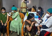 Health workers administer Covid-19 vaccine dose to beneficiaries during a vaccination drive for tribal people at Aarey Colony in Mumbai on 3 August, 2021 | PTI