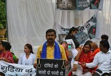 People protest against the gangrape and murder of a 9-year-old Dalit girl who was 'forcibly cremated' by the accused, in Delhi on 3 August 2021 | Suraj Singh Bisht | ThePrint