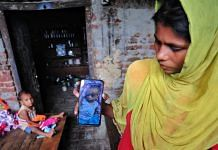 Nazrana shows the only photo she has of her infant son Rehan, who was allegedly killed by her husband earlier this week. Her daughter Rehnuma is seen in the background   Suraj Singh Bisht   ThePrint