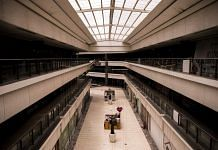 A shopping mall deserted during lockdown restrictions in Noida, India | Bloomberg