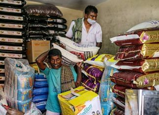 Representational image | Workers unload sacks of rice at a grocery store in Bengaluru in June 2021 | Dhiraj Singh | Bloomberg