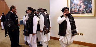 Members of Afghanistan's Taliban delegation ahead of an agreement signing between them and US officials in Doha, Qatar in February 2020| ANI via Reuters