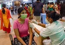 A beneficiary receives a Covid-19 vaccine at a district hospital in Noida, in August 2021 | PTI