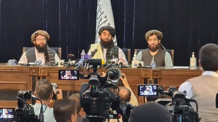 Taliban spokesperson Zabihullah Mujahid (middle) during a press conference in Afghanistan, on 17 August 2021   Twitter/@paykhar