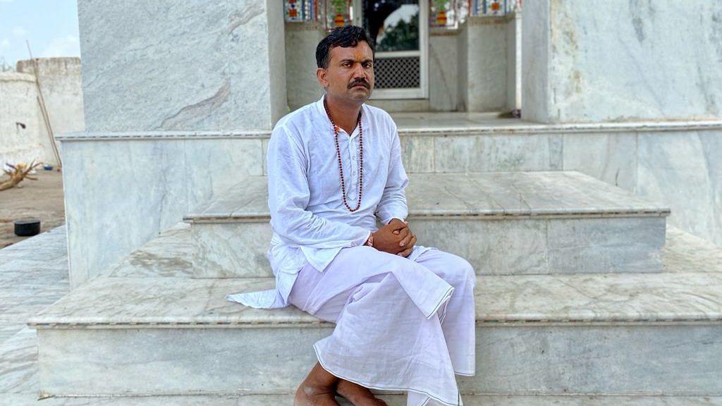 The priest at the temple, Shrawan Kumar Meena | Photo: Nirmal Poddar/ThePrint