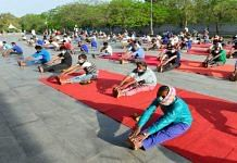 People residing in the makeshift camp at Yamuna sports complex in Delhi perform yoga in April 2020   Representational image   PTI