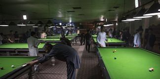 File photo of men playing snooker at a billiards club in Kabul, Afghanistan in 2017 | Photo: Victor J. Blue | Bloomberg
