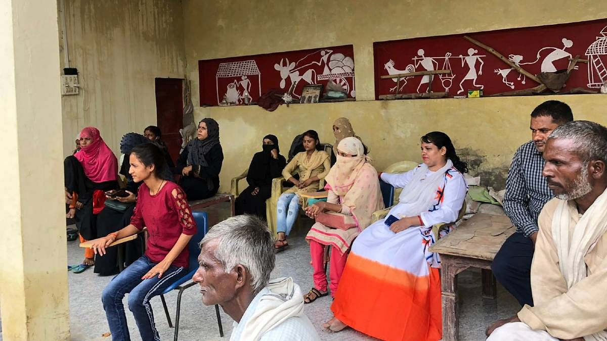Survivors of abuse wait for their turn to discuss their cases with the Chingari Adalat representatives   Jyoti Yadav   ThePrint