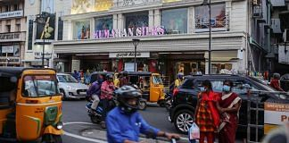 Vehicles travel past stores in Chennai   Representational image   Photographer: Dhiraj Singh   Bloomberg