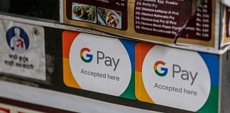 A store advertises the use of the Google Pay digital payment system in Mumbai