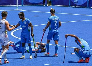 Indian players react after their men's field hockey semifinal match against Belgium, at the 2020 Summer Olympics, in Tokyo, on 3 August 2021 | PTI