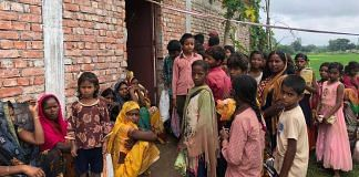 In Sobhadra students and their parents wait to receive MDM ration | Jyoti Yadav |ThePrint