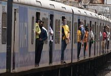A local train leaves from Dadar station in Mumbai, on 21 June 2021