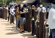 File photo of people waiting to refill their medical oxygen cylinders for Covid patients at an oxygen refilling factory in New Delhi | R Raveendran | ANI