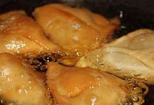Samosas frying in oil