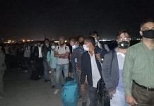 People stand in a queue to board IAF's special repatriation flight from Kabul, on 22 August 2021   Twitter/@MEAIndia