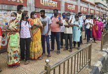 File photo of people waiting in queue in Mumbai to receive their Covid vaccine doses | Representational image | PTI