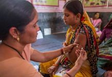 A health worker immunises a pregnant woman at a health centre in Aurangabad (Representational image) | Bloomberg