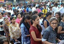 Applicants wait outside an examination centre to appear for NEET | Representational Image | PTI