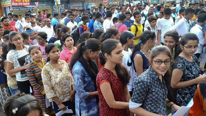 Applicants wait outside an examination centre to appear for NEET   Representational Image   PTI