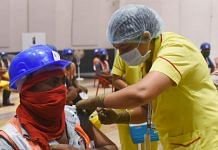 Representational image of a construction worker being vaccinated against Covid-19 | Photo: ANI
