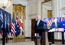 US President Joe Biden (centre) flanked by screens featuring Australian PM Scott Morrison (left) and UK PM Boris Johnson at the announcement of the new AUKUS partnership | Photo: Bloomberg