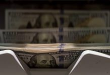 A machine counts a stack of US 100 dollar banknotes | Representational image | Bloomberg