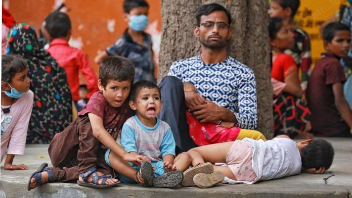 Parents and children wait outside the district hospital in Firozabad   Manisha Mondal   ThePrint