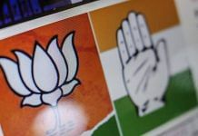 Logos for the Bharatiya Janata Party (BJP), left, and the Indian National Congress (INC) party are displayed on a computer at the Boom Live office in Mumbai | Bloomberg