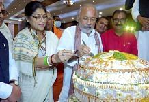 BJP leaders and workers cut a 71-kg laddoo on the eve of the PM's birthday to celebrate | ANI