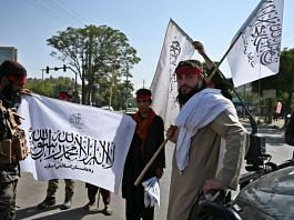 Taliban members hold the insurgent group's flags | Representational Image| Photographer: Wakil Kohsar/AFP/Getty Images via Bloomberg