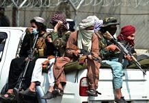Taliban fighters guard outside the airport in Kabul on 31 August 2021 | Bloomberg