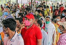 People wait to receive Covid-19 vaccine dose during a vaccination drive in Birbhum district, West Bengal on 21 September 2021 | PTI