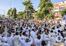 Farmers during their sit-in protest outside the Mini Secretariat in Karnal on 8 August 2021| PTI