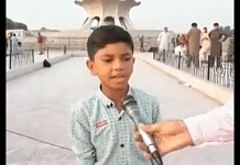 The boy from the viral clip can be seen singing in Punjabi at Minar-e-Pakistan in Lahore, Pakistan.   Picture credit: Twitter/@TheSkandar