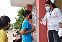 Students undergo a thermal screening process outside an exam centre as they arrive to appear for the NEET exam in Rajasthan's Bikaner on 12 September 2021 | Representational image | ANI