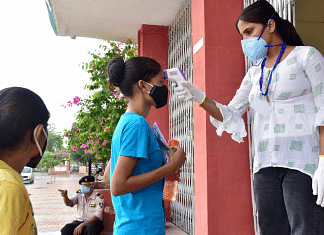 Students undergo a thermal screening process outside an exam centre as they arrive to appear for the NEET exam in Rajasthan's Bikaner on 12 September 2021   Representational image   ANI