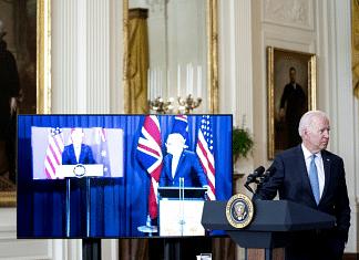 US President Joe Biden listens as Australian PM Scott Morrison speaks via videoconference during the announcement of the new AUKUS partnership on 15 September 2021   Photo: Stefani Reynolds   Bloomberg