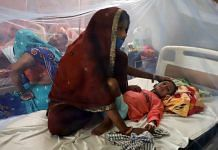 A mother takes care of her child as he receives a treatment during the ongoing fever outbreak, in UP on 8 September 2021| ANI