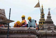 Construction workers build the main gate to the Kashi Vishwanath Dham | Photo: Praveen Jain | ThePrint