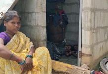 Sujatha sits outside the toilet while her children sleep inside | By special arrangement