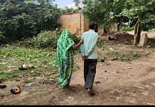 Roopmani Singh, 50, is guided by his wife to the hospital ground where patients go to relieve themselves | Shubhangi Misra | ThePrint