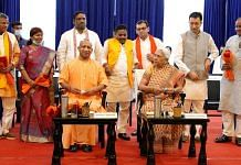 UP Chief Minister Yogi Adityanath (seated left) and Governor Anandiben Patel (seated right) with the newly inducted ministers in Lucknow Sunday   Photo: ANI