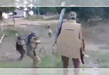 Screenshot from a grainy video of police firing at a lathi-wielding protester during the clashes in Darrang district's Dholpur village last week | Via Twitter