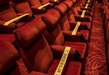 Tape is displayed on seats to implement safe distancing measures at a film theater in the PVR Icon cinema at the DLF Promenade Mall in New Delhi | Photographer: Anindito Mukherjee | Bloomberg