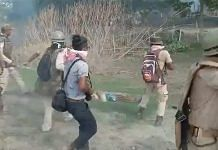 A screenshot from a purported video of the clashes between locals and police personnel in Assam's Darrang district on 23 September 2021. | Photo: Twitter/AshrafulMLA