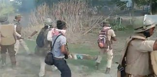 A screenshot from a purported video of the clashes between locals and police personnel in Assam's Darrang district on 23 September 2021.   Photo: Twitter/AshrafulMLA