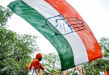 A Youth Congress supporter waves a party flag | Representational image | ANI File Photo