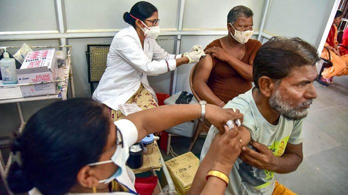 Health workers administer Covid-19 vaccines at a special vaccination camp targeting 1 lakh doses in a single day, in Bikaner, on 8 September 2021   PTI